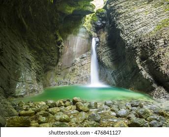 beautiful and mysterious waterfall in a cave, waterfall Kozjak, Kobarid, Slovenia