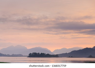 beautiful mystic sunset at glencoe and loch leven with fog and clouds