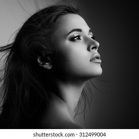 Beautiful mystic woman profile with long hair looking. Black and white portrait. CLoseup