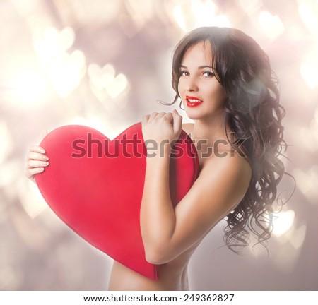 Beautiful Nacked Girl With Big Heart In Hands Portrait In Studio