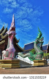 beautiful of  Naga in front of the church at Banden temple, Chiang Mai, Thailand. Naga  statue in front of the Thai temple and sky background. Thai modern  culture.