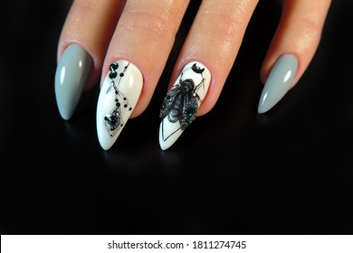 Beautiful nail design for Halloween with a butterfly and rhinestones, the handmade pattern.
