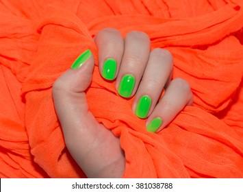 Beautiful nail polish in hand, close-up, green nail art manicure