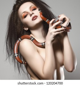beautiful naked girl with a snake