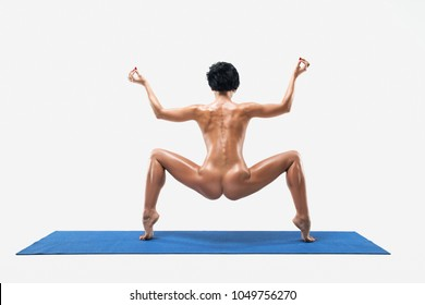 Beautiful Naked Woman With Perfect Body Practicing Yoga Poses In Studio Isolated On White Background