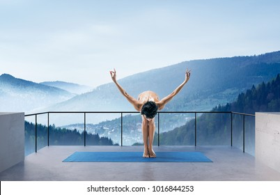 Beautiful Naked Woman Practicing Yoga Poses On Nature Outdoors