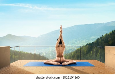 Beautiful Naked Woman Practicing Yoga Poses On Nature Outdoors During Daylight In Mountains