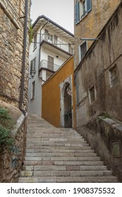 Beautiful narrow alley with upstairs in Brescia city. Historical architecture of the Lombardia region in Italy. Winter journey in North Italy. Travelling Europe.