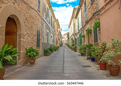 Beautiful narrow old street in mediterranean city.