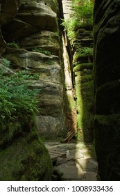 Beautiful narrow rock chasm in natural terrain with beam of light