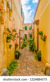 Beautiful narrow street in the picturesque Alghero old town, Italy