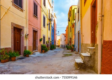 Beautiful narrow street in the picturesque Bosa old town, Italy. Colorful image of italian historic place.