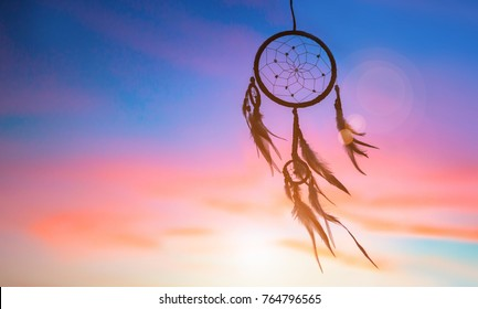 Beautiful native american dream catcher against sunset background