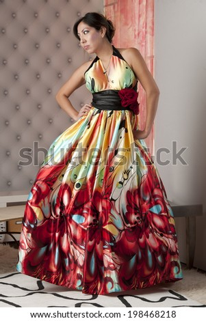6f1a5224eb3 Beautiful Native American model wearing colorful party dress in studio.
