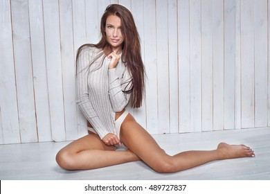 e257e4db2a79 Beautiful natural brunette woman with freckles on face. Slim legs. Long  hair. Girl