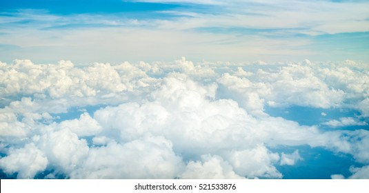 Beautiful natural cloudscape and sky Aerial view of Blue sky and top Cloud view or cloudy of bird eye view from airplane window.