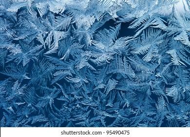 Beautiful natural frosty pattern on winter window.