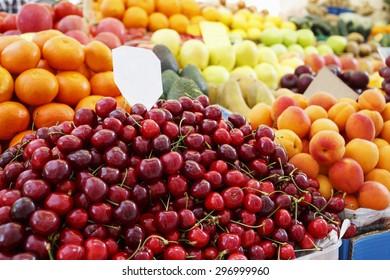 Beautiful natural fruit at summer market/Ripe sweet Cherries at the market