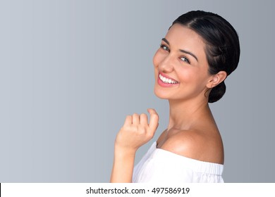 Beautiful natural fun vibrant hispanic woman smiling perfect skin teeth isolated space