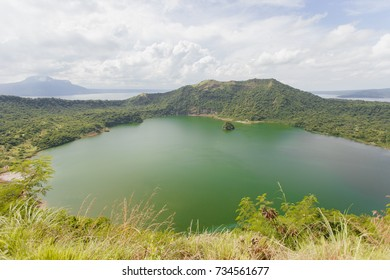 Beautiful natural lake inside the active volcano's crater in the Philippines, red sand rocks. Taal Volcano in Tagaytay, Philippines