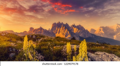Beautiful natural landscape. Fantastic Colorful sky over the Dolomites Alps during sunset. Cadini di Misurina range under sunlight. National Park Tre Cime di Lavaredo. Dolomite, South Tyrol.