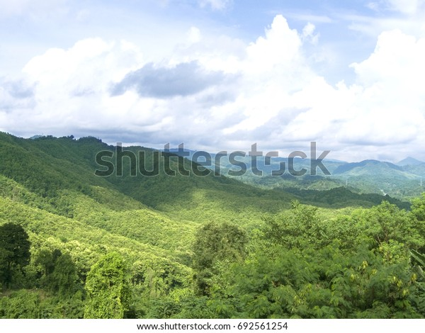 Beautiful natural, Landscape of green mountain range full of natural green forest and beautiful blue sky in a many clouds and sunlight of day Landscape..