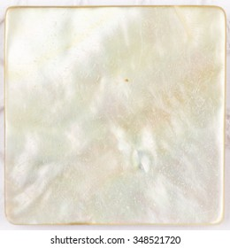 beautiful natural light with iridescent nacre pearl shimmering in the form of a square plate for mosaic