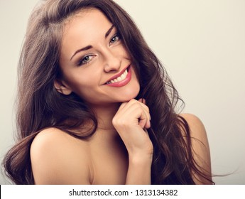 Beautiful natural makeup toothy smiling woman with long hair style. Skincare concept. Closeup portrait. Toned