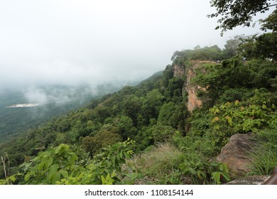 beautiful natural scenery of mist over green mountain.