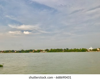 A beautiful natural scenery with a river and sky
