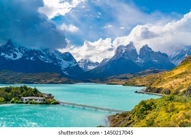 Beautiful natural view of Lake Pehoe and Cuerno del Paine Mountains with rain clouds in the sky at Torres del Paine National Park in, Chile.