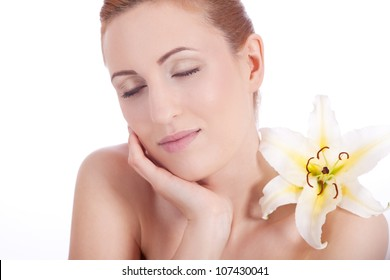 beautiful natural woman face with flower isolated on white
