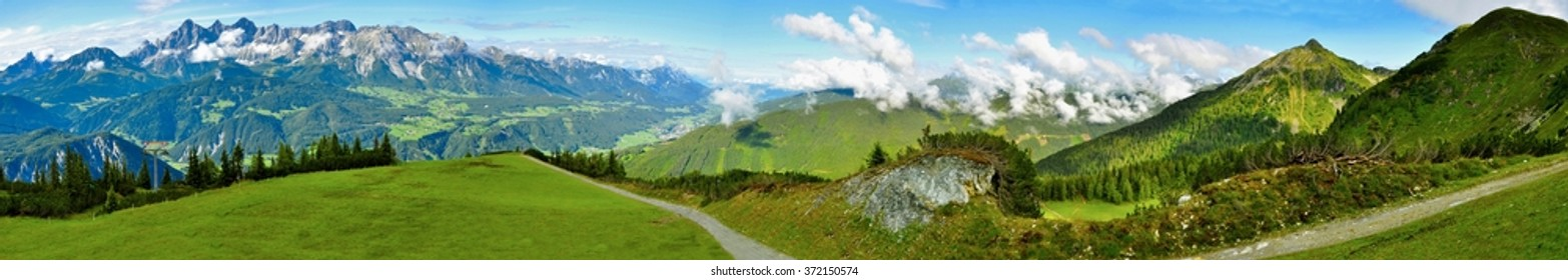 Beautiful nature of Austrian Alps with Dachstein and path in summer.Nature panorama.Alps Panorama.Panorama.Alps.Swiss.Europe.Swiss Panorama of Alps.Europe Alps.Summer.Landscape.Panoramic.Summer Alps