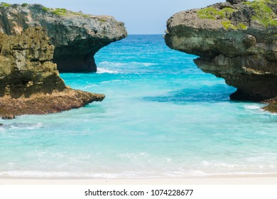 Beautiful nature of blue sea sand and white waves at Pantai Mandorak, Sumba, Indonesia