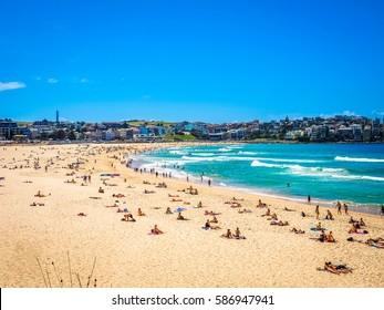 Beautiful Nature of Bondi Beach in Sydney, Australia. People enjoy swimming, surfing, and sunbathing.