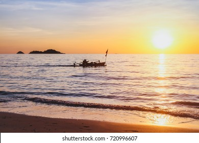 beautiful nature, exotic beach at sunset with silhouette of fisherman boat, inspiring tropical landscape background with copy space