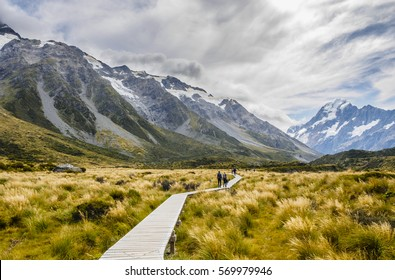Beautiful Nature of Hooker Valley with Glacier Mountains in New Zealand. Travelers walk the trail in Mt. Cook.