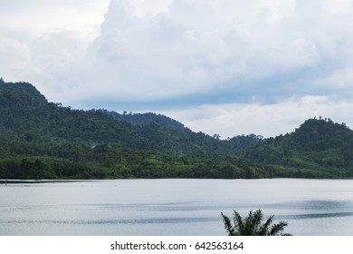 beautiful nature, lake surrounded by hill over cloudy sky background