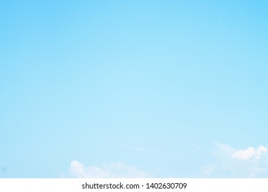 Beautiful nature landscape background of Natural Bright blue sky with white puffy & fluffy soft clouds in spring morning sunlight, copy space. Wide angle view of pastel vast sky with minimal clouds