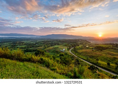 Beautiful nature landscape of the colorful sky and mountains during the sunrise at Khao Takhian Ngo View Point, Khao Kho attractions in Phetchabun, Thailand