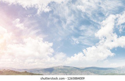 Beautiful nature landscape with high mountains and cloudly skyscape.