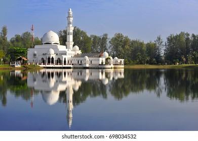 Beautiful nature landscape of Terengganu, Malaysia, Masjid Tengku Tengah Zaharah Muslim Mosque with reflection and blue sky ( selective focus)