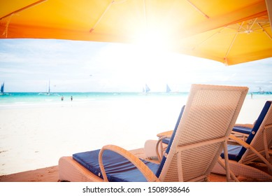 Beautiful nature landscape of tropical island at daytime. Lounge chairs on the beach.