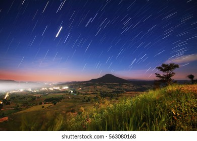 The Beautiful of nature and the night sky filled with stars at  (Khao Takhian Ngo View Point ) , Khao Kho District ,Phetchabun Province in Thailand.