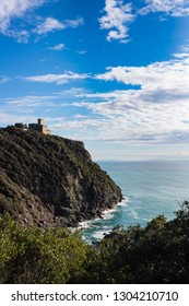 Beautiful nature on Livorno rocky coast. On background Sonnino Castle on a cliff overlooking the sea. Livorno, Tuscany, Italy