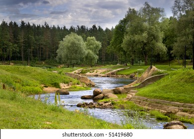 Beautiful nature park on a summer day in city of Valmiera, Latvia. This is a clean and green park with a special training track for canoe and kayak discipline. it's a good atmosphere for relaxation.