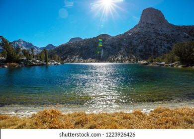 Beautiful nature scene in autumn mountains. Sierra Nevada lake reflection.
