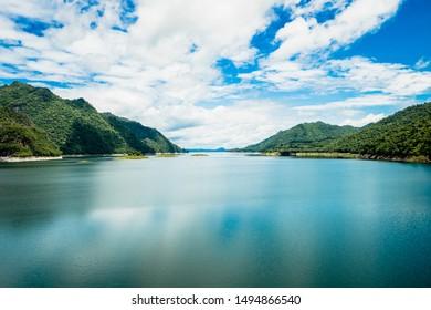 Beautiful nature scenic landscape with mountain range clear view on blue sky in the morning at Vajiralongkorn Dam, Kanchanaburi, Thailand.
