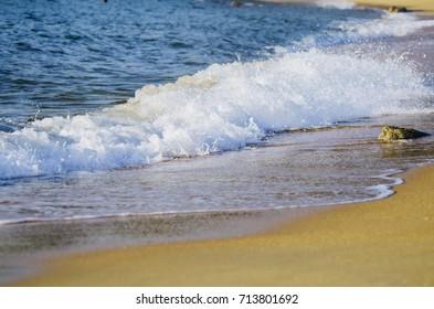 Beautiful nature, splashing wave while hitting the rock at the beach