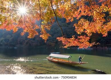 Beautiful nature view of Arashiyama in autumn season along the river in Kyoto, Japan. Arashiyama is a one of attraction landmark for tourist in Kyoto, Japan.
